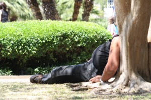 image of man with a beer belly taking a nap
