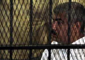 image of a sad man in a cage